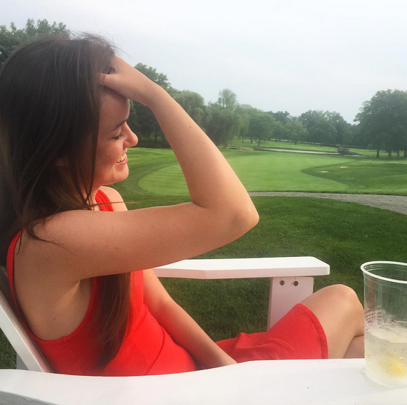 Casey looking stunning as always...casual hairflip while watching golfers on the 18th hole.