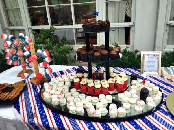The most delicious dessert table...marshmallows, chocolate covered oreos, and cupcakes, Oh My!